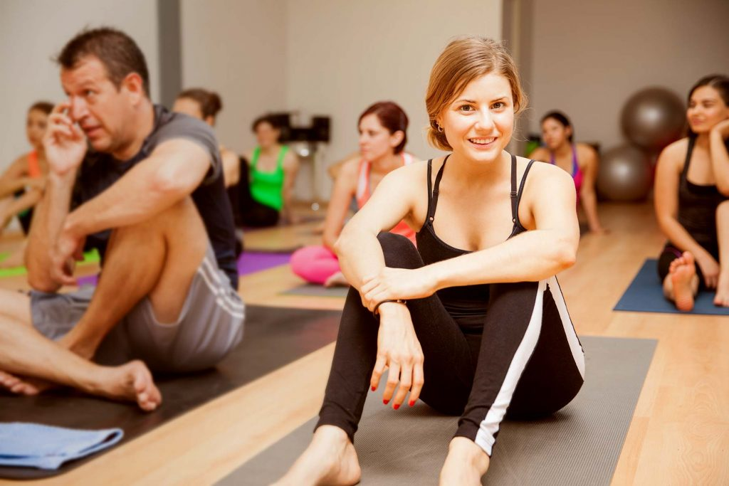 woman smiling in yoga class