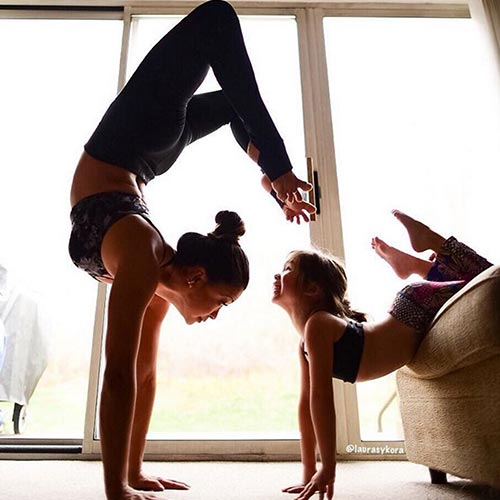 laura sykora yoga pose with child