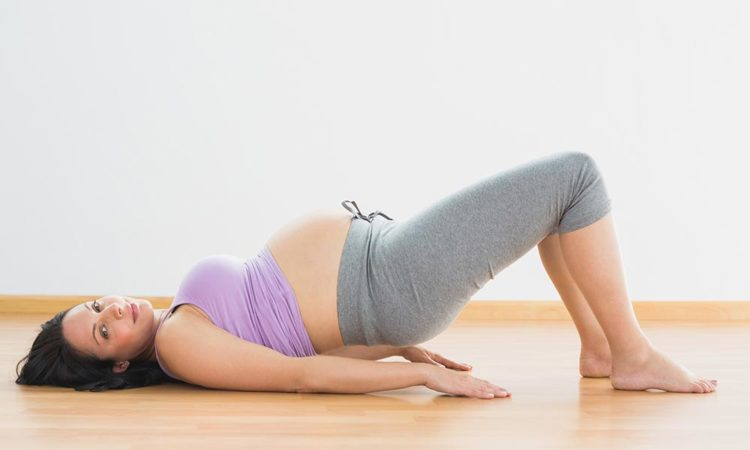 woman doing yoga pose to strengthen pelvic floor
